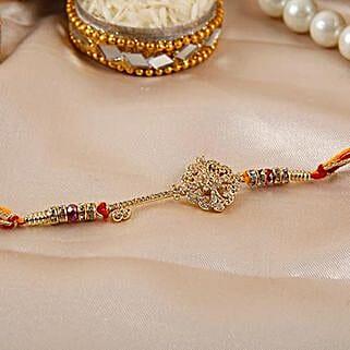 Key Shaped American Diamond Rakhi: Send Rakhi to Brazil