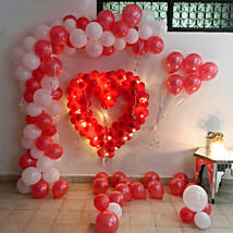 Glowing Red & White Balloon Decor: Anniversary Decoration Services