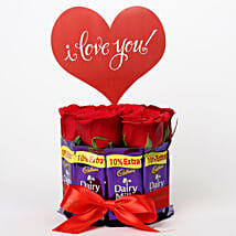 Red Roses in Glass Vase & Dairy Milk Arrangement: Valentine Gifts for Husband