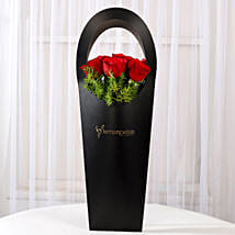 Red Roses in Stylish Black Sleeve: Romantic Flowers