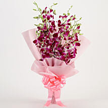 Splendid Purple Orchids Bouquet: Send Wedding Gifts to Surat