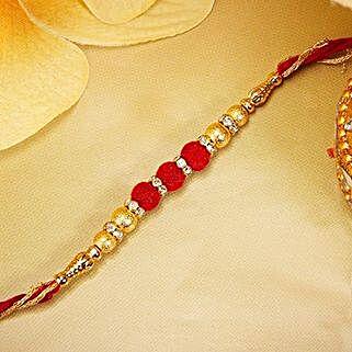 Gold And Red Velvet Beads Rakhi: Send Rakhi to Switzerland