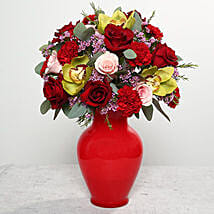 Mixed Flowers In Red Glass Vase: Send Anniversary Flowers to UAE