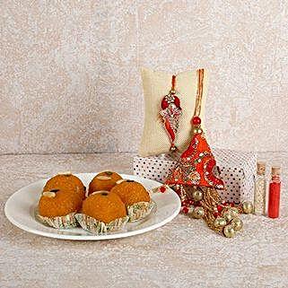 Orange Lumba And Laddoo Combo: Rakhi With Sweets to UAE